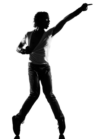 michael jackson: full length silhouette of a young man dancer dancing funky hip hop r&b on  isolated  studio white background
