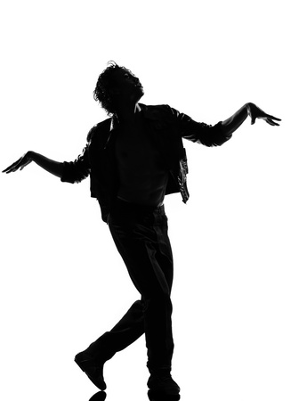 full length silhouette of a young man dancer dancing funky hip hop r&b zombie walk on  isolated  studio white background photo