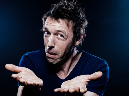 studio portrait on black background of a funny expressive caucasian man hesitant puckering Stock Photo - 11764817