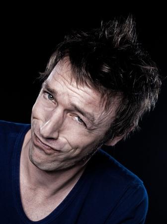 handsign: studio portrait on black background of a funny expressive caucasian man