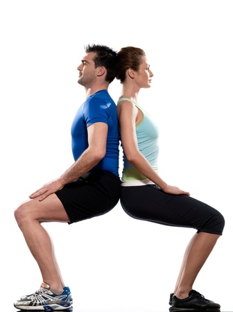 squats: couple doing workout back to back on white isolated background