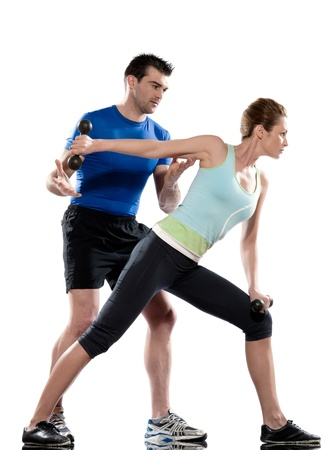 lunges: one caucasian couple man aerobic trainer positioning woman  Workout coach Posture in indoors studio isolated on white background Stock Photo
