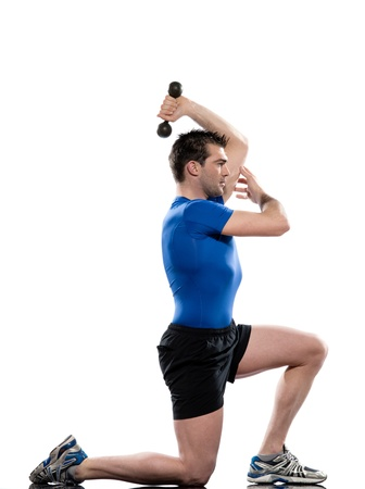 triceps: man doing workout on white isolated background. Lunges Triceps Stretch