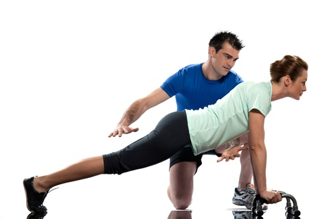 one caucasian couple man aerobic trainer positioning woman  Workout coach Posture in indoors studio isolated on white background Stock Photo