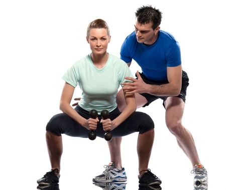 squat: couple man and woman exercising workout on white background