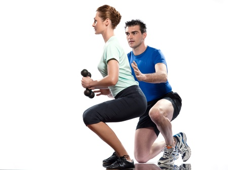 squats: couple man and woman exercising workout on white background