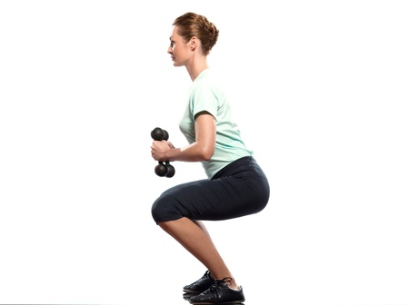 crouches: one beautiful caucasian woman exercising Weight Training workout on studio isolated white background Stock Photo