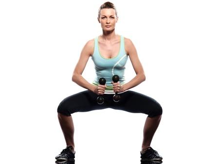 crouches: woman exercising workout on white background Stock Photo