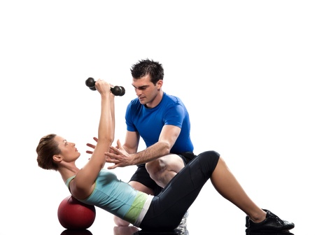 pectorals: one caucasian couple man aerobic trainer positioning woman  Workout coach Posture in indoors studio isolated on white background Stock Photo