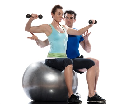 personal trainer: one caucasian couple man aerobic trainer positioning woman  Workout coach Posture in indoors studio isolated on white background Stock Photo