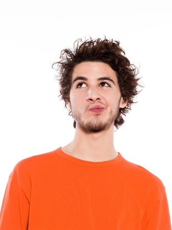 unsure: young thinking caucasian man portrait in studio on white background Stock Photo