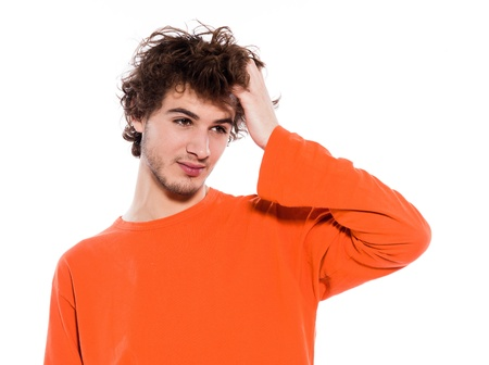 young thinking sleepy caucasian man portrait in studio on white background photo