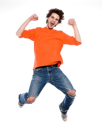 leaping: one expressive caucasian young man screaming happy joy full length in studio on white background