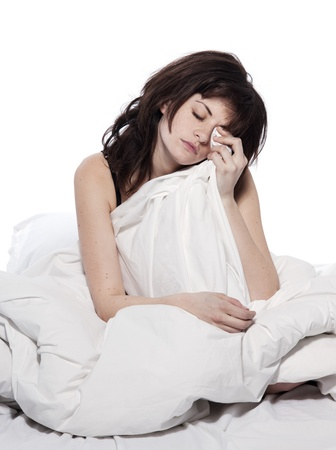 one young woman in bed awakening tired insomnia hangover  in a white sheet bed on white background Stock Photo - 11752440