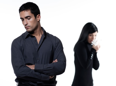 infidelity: one young couple relationship difficulties dispute with woman crying on studio isolated white background Stock Photo