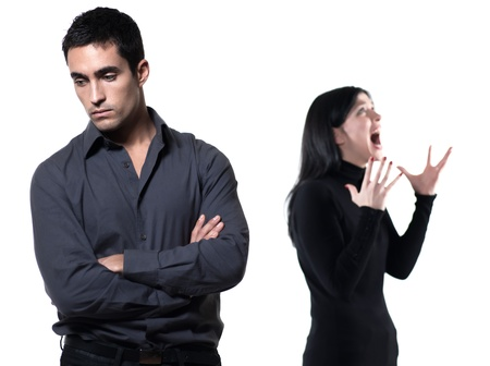 relationship problems: young couple on white background having a dispute