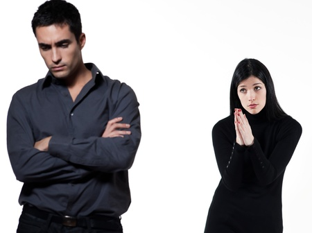 timidity: young couple on white background having a dispute