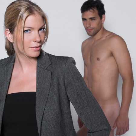 naked man: woman seductress with man naked in studio on isolated grey background