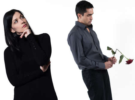 relationship problems: amn offering a rose to a woman
