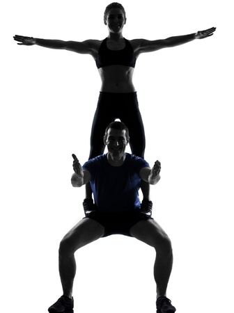 couple woman man exercising workout fitness aerobics posture in silhouette studio isolated on white background Stock Photo - 12710714