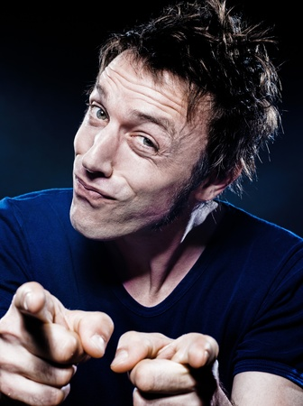 studio portrait on black background of a funny expressive caucasian man pointing puckering hesitant Stock Photo - 12710808