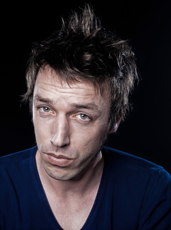 studio portrait on black background of a funny expressive caucasian man puckering displeased Stock Photo - 12710806