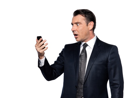handsome caucasian man looking at phone stun portrait isolated studio on white background photo