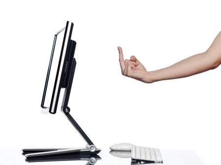 communication between human hand and a computer display monitor on isolated white background expressing obscene gesture concept photo