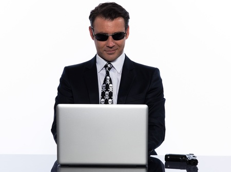 man caucasian hacker computer attack isolated studio on white background Stock Photo - 12710774