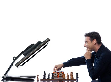 caucasian man playing chess with computer concept on isolated white background photo