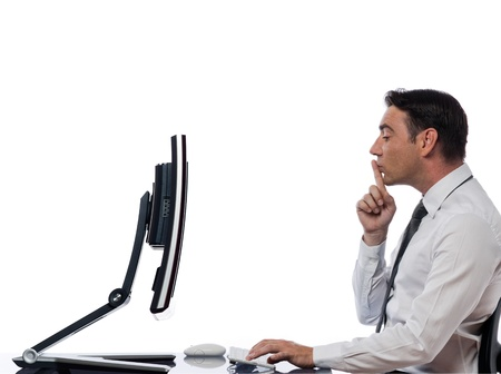 mistrust: one  caucasian man computing computer display monitor hushing expressing secrecy concept on studio isolated white background