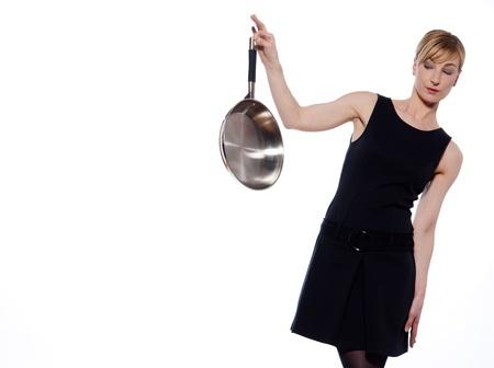hesitancy: beautiful woman on studio white background holding a frying pan Stock Photo
