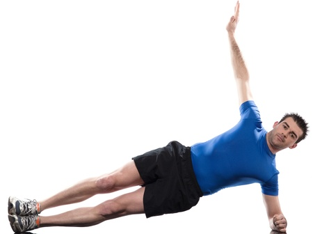 man lying on side  Abdominals workout posture on studio isolated  white background photo