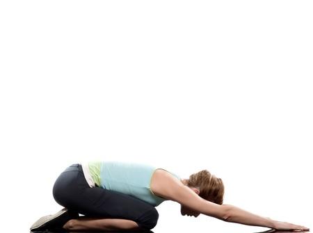woman pose: woman adho mukha virasana child pose yoga stretching workout posture on studio white background