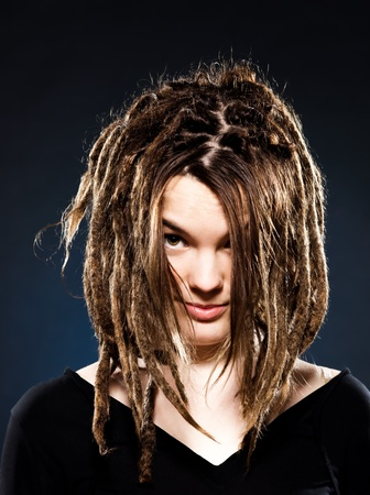 dreadlock: studio shot portraits of a young blond caucasian woman with dreadlocks on black background