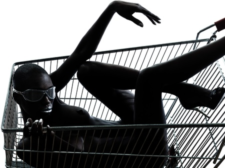 one beautiful black african naked woman sitting inside in a caddy shopping cart in studio isolated on white background photo