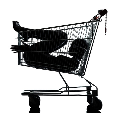 one beautiful black african naked woman sitting inside in a caddy shopping cart in studio isolated on white background Stock Photo - 12896830