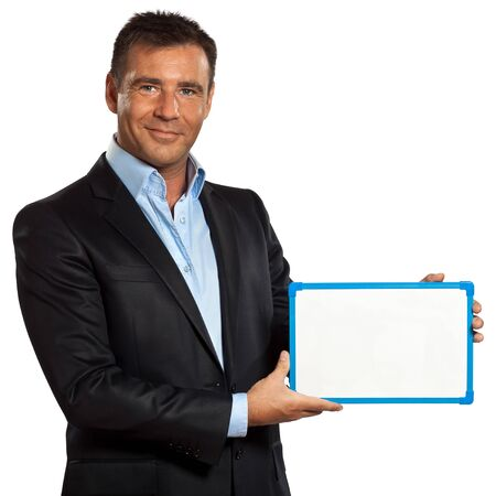 holding a sign: one caucasian business man holding showing whiteboard in studio isolated on white background