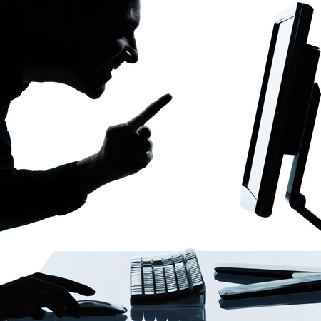 one caucasian business man computing computer  happy success portrait silhouette in studio isolated on white background Stock Photo - 12896754