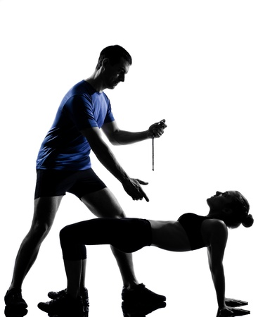couple woman man exercising workout fitness aerobics posture in silhouette studio isolated on white background Stock Photo - 12896750
