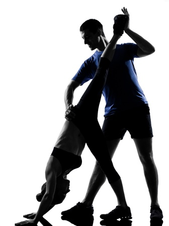 couple woman man exercising workout fitness aerobics posture in silhouette studio isolated on white background Stock Photo - 12970521