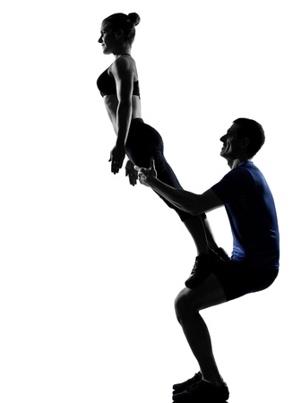 two women and one man: couple woman man exercising workout fitness aerobics posture in silhouette studio isolated on white background