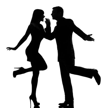 woman dancing: one caucasian couple man and woman dancing rock in studio silhouette isolated on white background