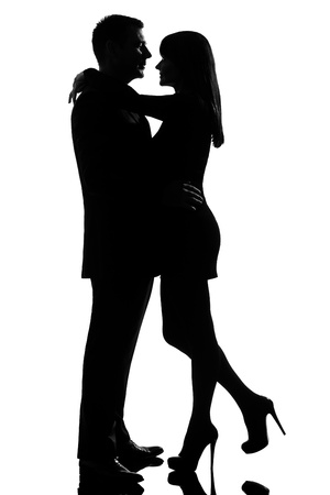 seductress: one caucasian lovers couple man and woman hugging tenderness in studio silhouette isolated on white background