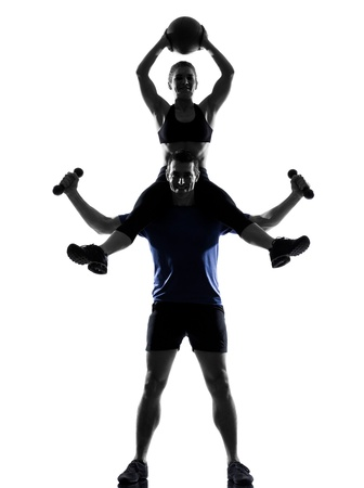 couple woman man exercising workout fitness aerobics posture in silhouette studio isolated on white background Stock Photo - 12896743