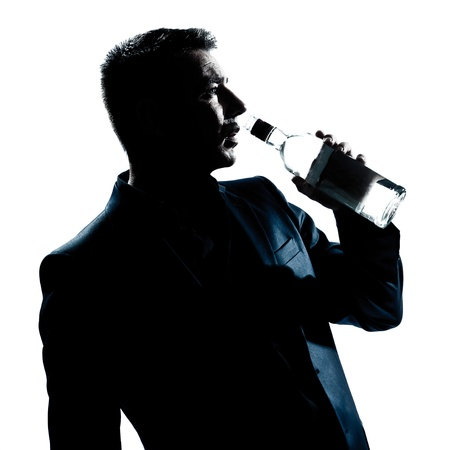 one caucasian man portrait silhouette drunk puring empty alcohol botlle in studio isolated white background Stock Photo - 12896610