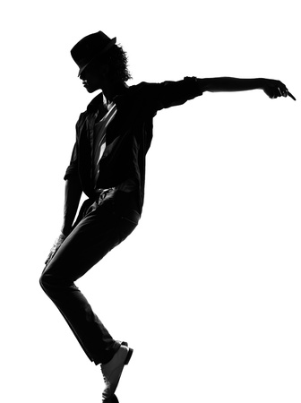 break dance: full length silhouette of a young man dancer dancing funky hip hop r&b on  isolated  studio white background