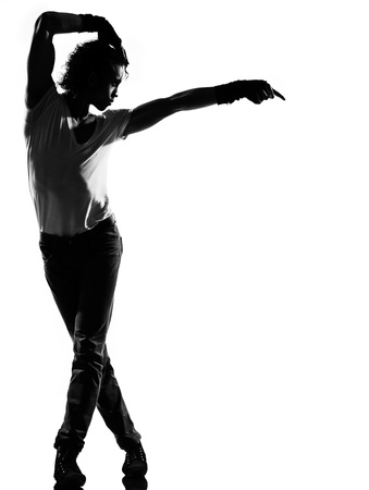 dancers: full length silhouette of a young man dancer dancing funky hip hop r&b on  isolated  studio white background