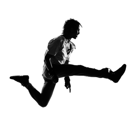 full length silhouette of a young man dancer dancing funky hip hop r&b on  isolated  studio white background Stock Photo - 12896560