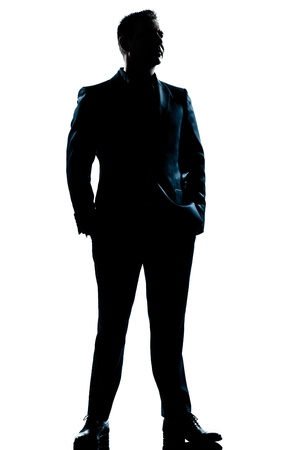 caucasianos: one caucasian  business man  handsome full suit standing full length serious silhouette in studio isolated white background Banco de Imagens